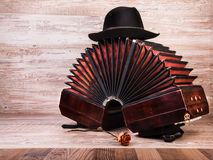 Bandoneon, tango instrument, and a hut Royalty Free Stock Photography