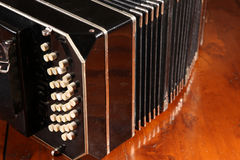 Bandoneon on wooden surface Royalty Free Stock Image