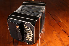 Bandoneon on wooden surface Royalty Free Stock Photo