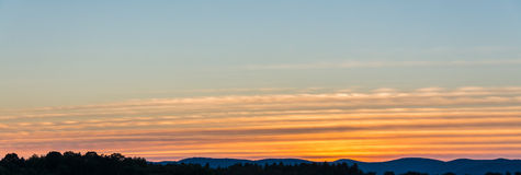 Bands Of Yellow and Orange Cirrus Clouds Stock Photos