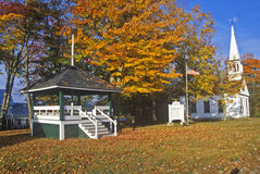 Bandstand with church and steeple in Fall, Effingham, NH