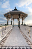 Bandstand victorian brighton england. Victorian bandstand by brighton beach in sussex england. metal construction and pavilion Royalty Free Stock Photos