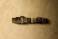 BANDWIDTH - close-up of grungy vintage typeset word on metal backdrop Stock Photos