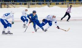 Bandy match Dynamo(white) vs Zorkij(blue) Royalty Free Stock Image