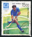 Bandy player. INDIA - CIRCA 2004: stamp printed by India, shows bandy player Games of the XXVIII Olympiad, circa 2004 Stock Images