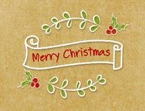 Baner för band för glad jul för tappning i klotterstil på hantverk p Royaltyfri Foto