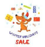 Baner för försäljning för vinterferier med hunden i jultomtenhatt Arkivbild