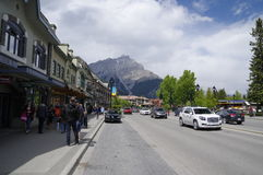 BANFF, ALBERTA. MAY 28: Banff Avenue on May 28, 2016 in Banff National Park, Alberta, Canada. Banff Avenue is the central shopping district in the town of Royalty Free Stock Photography