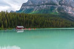 Boaters on Lake Louise in Banff. Banff, Canada -- August 03, 2018.  Boaters prepare to paddle out onto the turquise waters of Lake Louise in Banff, Canada with Royalty Free Stock Photo