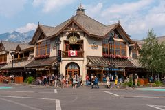 The Town Center, Banff Canada. Banff, Canada--August 2, 2018.  Shoppers and pedestrians throng the streets of Banff during the height of the tourist season Stock Photography