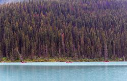 Tourists in Red Canoes in Banff royalty free stock photography