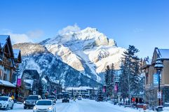 Winter in Banff Townsite in the Canadian Rockies, Canada. BANFF, CANADA - DEC 22, 2017: Winter scene on Banff Avenue in the Banff National Park with Cascade Royalty Free Stock Photography