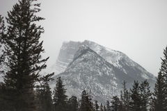 Banff Canada, Foggy Mountain. Mountain in the distance engulfed in fog Royalty Free Stock Image