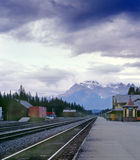 Banff CPR Train Station, Alberta, Canada. Banff station at dusk, with the  Fairholme mountain range as a backdrop. 6x7 Fujichrome drum scan Royalty Free Stock Photo