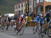 Banff national park bikefest. These racers are coming around the corner onto banff avenue,in this bikefest race held at banff alberta ,canada, june 18 to june 21 Royalty Free Stock Photo