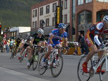 Banff national park bikefest. Bikes coming around the corner at the banff national park bikefest. these bikes are in the fulcrum criterium race.this is fast Royalty Free Stock Photos