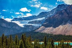 Banff National Park, Glacier Crowfoot. Canada, Rocky Mountains, Alberta, Banff National Park. The Glacier Crowfoot over Bow River in an environment of bright royalty free stock images