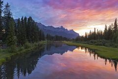 Banff National Park Rocky Mountain Sunset. Burning Red Sunset Skies over town of Canmore after late afternoon summer thunderstorm in Banff National Park Rocky stock image