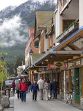 Banff. Pedestrians walk along a store-fronted street in the town of Banff in Alberta, Canada Royalty Free Stock Image