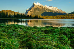 Banff Vermilion Lake Mountain  sunset. Sunset at vermilion lake with rundle mountain as background in banff national park, canada. Grass was forming round shape Royalty Free Stock Photos