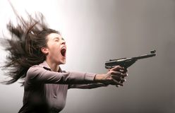 Bang 10. A woman screaming with a gun Royalty Free Stock Photo