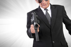 Bang! Bang! Bang!. Pointed gun of a man in black suit, crime action movie concept background, with dramatized effect Stock Image