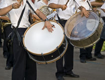 Bang the Drums. Young men playing the drums in a street parade Stock Photography