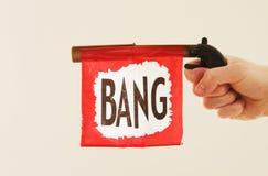 Bang Fake Gun Sound. A bang flag coming out of a gun as a joke royalty free stock photography