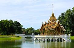 Bang Pa-In Aisawan. Artificial lake with bridge and temple in Thipya-Art at the Royal Summer Palace near Bangkok, Thailand Royalty Free Stock Image