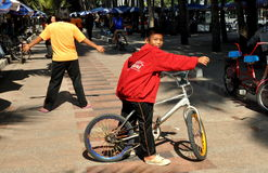 Bang Saen, Thailand: Boy on Bicycle on Promenade Royalty Free Stock Photo