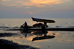 Bang Saen,Thailand: Driver Pulling Banana Boat along Beach Royalty Free Stock Photos
