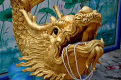 Bang Saen, Thailand: Gilded Dragon with Pearls Stock Photography