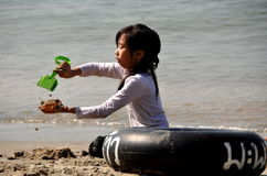 Bang Saen, Thailand: Little Girl Playing in Sand Stock Photo