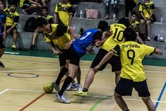 BANG SAN, THAILAND - June 3, 2017 : Men are kicking football in the finals of the semi-finals of a Thai company. royalty free stock image