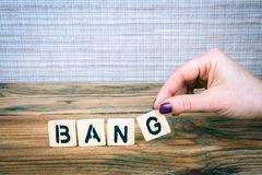 Bang. Wooden letters on the office desk royalty free stock photography