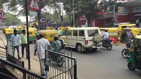 Bangalore, India - 30 JAN 2017: A street and traffic scene from the side of a busy road in Bangalore, India, with tuk. Tuks, cars and motorcycles making their stock video