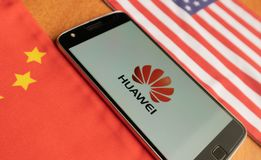 Bangalore, India, June 4, 2019 : Huawei Logo in Mobile, kept in between the US and china flag stock photography