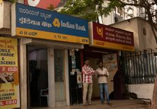BANGALORE INDIA June 3, 2019 :People talking infront of the Indian bank ATM and Punjab national bank ATM at bangalore railway royalty free stock image