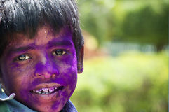 Young boy with face painted in colors during India Stock Photo