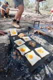 Bacon and eggs or toad in a hole being cooked on the open camp fire royalty free stock photo