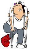 Banged up man on crutches Stock Photography