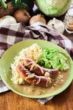 Bangers and Mash. Baked sausage in onion gravy Royalty Free Stock Image