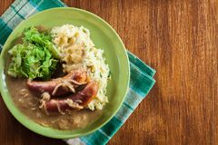 Bangers and Mash. Baked sausage in onion gravy Stock Image