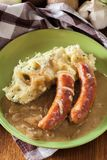 Bangers and Mash. Baked sausage in onion gravy Royalty Free Stock Images