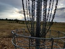 Banging the chains. Banging chains  discgolf winning gothrow royalty free stock image