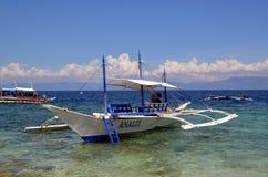 Bangka boat in the ocean Stock Photo