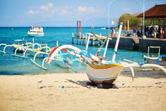 Bangka boats on the sea shore in Balinese village Royalty Free Stock Photos