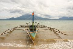 Bangkas, a traditional type of outrigger boats used by Filipino artisanal fishermen. Bankas or bangkas are traditional outrigger wooden boats used by Filipino Stock Images