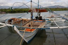 Bangkas, a traditional type of outrigger boats used by Filipino artisanal fishermen. Bankas or bangkas are traditional outrigger wooden boats used by Filipino Royalty Free Stock Photography