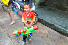 BANGKOK - 2012 APRIL 13: Songkran Festival. KHAO SAN ROAD, BANGKOK - 2012 APRIL 13: Kid playing in Songkran Festival royalty free stock photos